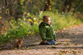 Little boy and squirrel Royalty Free Stock Photos