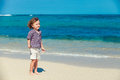 Little boy standing on the beach at day time Stock Photo
