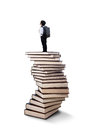 Little boy standing on books stack Royalty Free Stock Photo