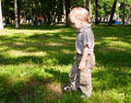 image photo : Little boy standing in park