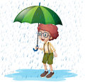 Little boy standing in rain