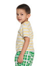 Little boy striped shirt looks back white background Royalty Free Stock Images