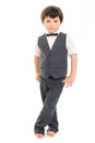 Little boy in suit portrait of a a and on bare feet against a white background Royalty Free Stock Images
