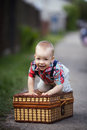 Little boy with suitcase cute funny outdoors Stock Photo