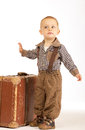 Little boy with suitcase old brown goes into the world Stock Photos