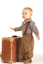 Little boy with suitcase old brown goes into the world Stock Image