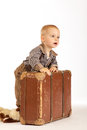 Little boy with suitcase old brown goes into the world Royalty Free Stock Photo