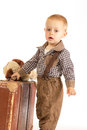 Little boy with suitcase old brown goes into the world Stock Photography