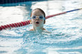 Little boy swimmer in a butterfly stroke Royalty Free Stock Photo