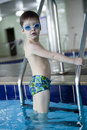 Little boy swimmer in the pool Stock Image