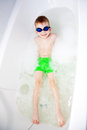 Little boy swimming in bath in glasses for diving a the wearing Royalty Free Stock Photography