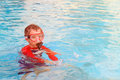 Little boy swimming with mask in outdoor pool