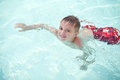 Little boy swimming in a pool Royalty Free Stock Photos