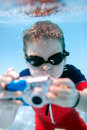 Little boy swimming underwater Stock Images