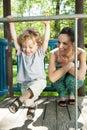 Little boy swinging on monkey bars Royalty Free Stock Photo