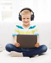 Little boy with tablet pc and headphones at home childhood leisure technology music concept smiling computer Stock Photography