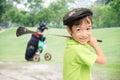 Little Boy Taking Golf Club On...