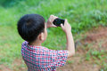 Little boy taking photos by digital camera on smartphone Royalty Free Stock Photo