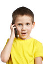 Little boy talking on phone isolated Stock Image