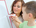 Little boy with teacher near whiteboard Stock Image