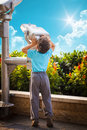 Little boy with telescope gazing the sky outdoor Stock Images