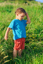 Little boy thinking hard on green grass lawn Stock Photography