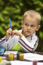 Little boy thinking with a pencil while drawing. Education. Royalty Free Stock Photo