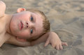 Little boy thoughtful on a sandy beach Stock Photos