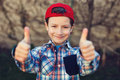 Little boy thumbs up vintage in cap outdoor portrait Royalty Free Stock Image