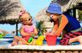 Little boy and toddler girl playing in swimming Royalty Free Stock Photo