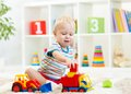 Little boy toddler playing with toy car Royalty Free Stock Photo