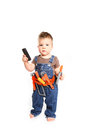 Little boy with tools and mobile phone on a white background Royalty Free Stock Photo