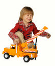 The little boy with a toy - a truck crane Stock Photos