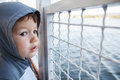 Little boy travel on ship lake Royalty Free Stock Photo