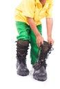 Little boy try wearing big shoe Royalty Free Stock Photo