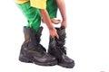 Little boy try wearing big shoe