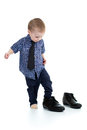 Little boy trying on father's shoes Royalty Free Stock Photo
