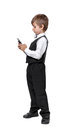 Little boy in a tuxedo calls on the phone isolate on white background Stock Photography