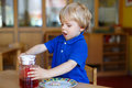Little boy of two years having breakfast at nursery blond Royalty Free Stock Images