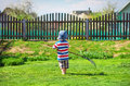 A little boy of about two years old in the garden. Royalty Free Stock Photo