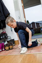 Little Boy tying his shoes Stock Photos