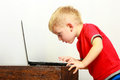 Little boy using laptop pc computer at home Royalty Free Stock Photo