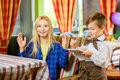 Little boy waiter accepts the order in a cafe or Royalty Free Stock Photo