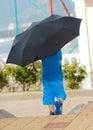 Little boy walks under the umbrella outdoor Stock Images