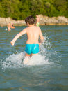 LIttle boy in water Royalty Free Stock Photo