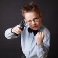 A little boy with a weapon on black background Stock Photography