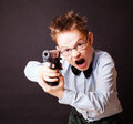A little boy with a weapon on black background Royalty Free Stock Photo