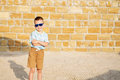 Little boy wearing blue mirror sunglasses against the yellow bri Royalty Free Stock Photo