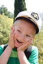 A little boy wearing a cap captain Stock Images