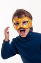Little boy wearing a gold carnival mask pretending to be a superhero Royalty Free Stock Photos